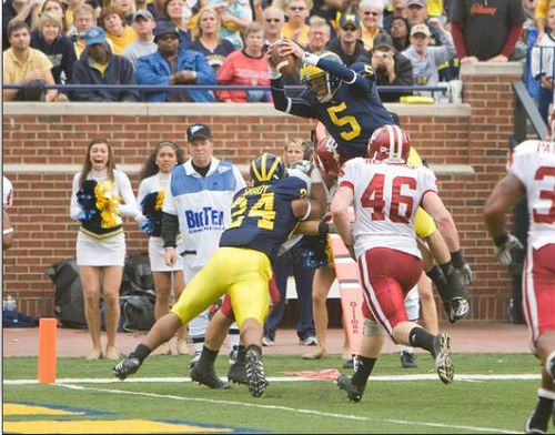 Tate Forcier dives into the endzone